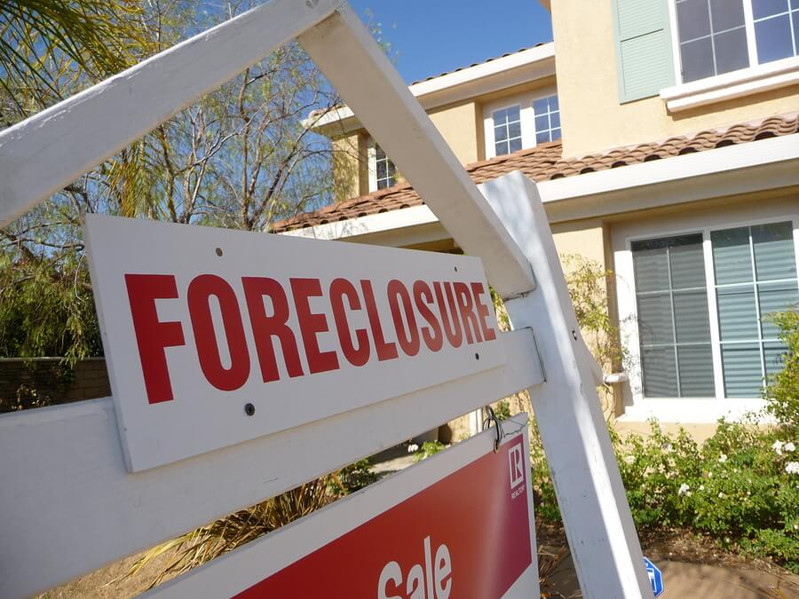 Photo of foreclosure sign in front of house