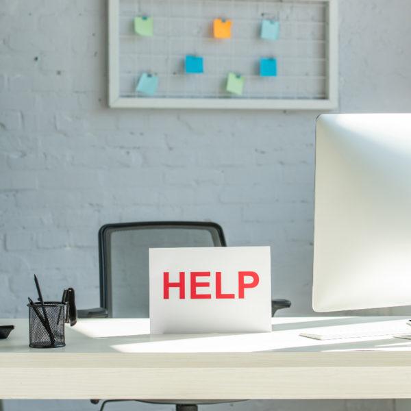 help sign at office desk