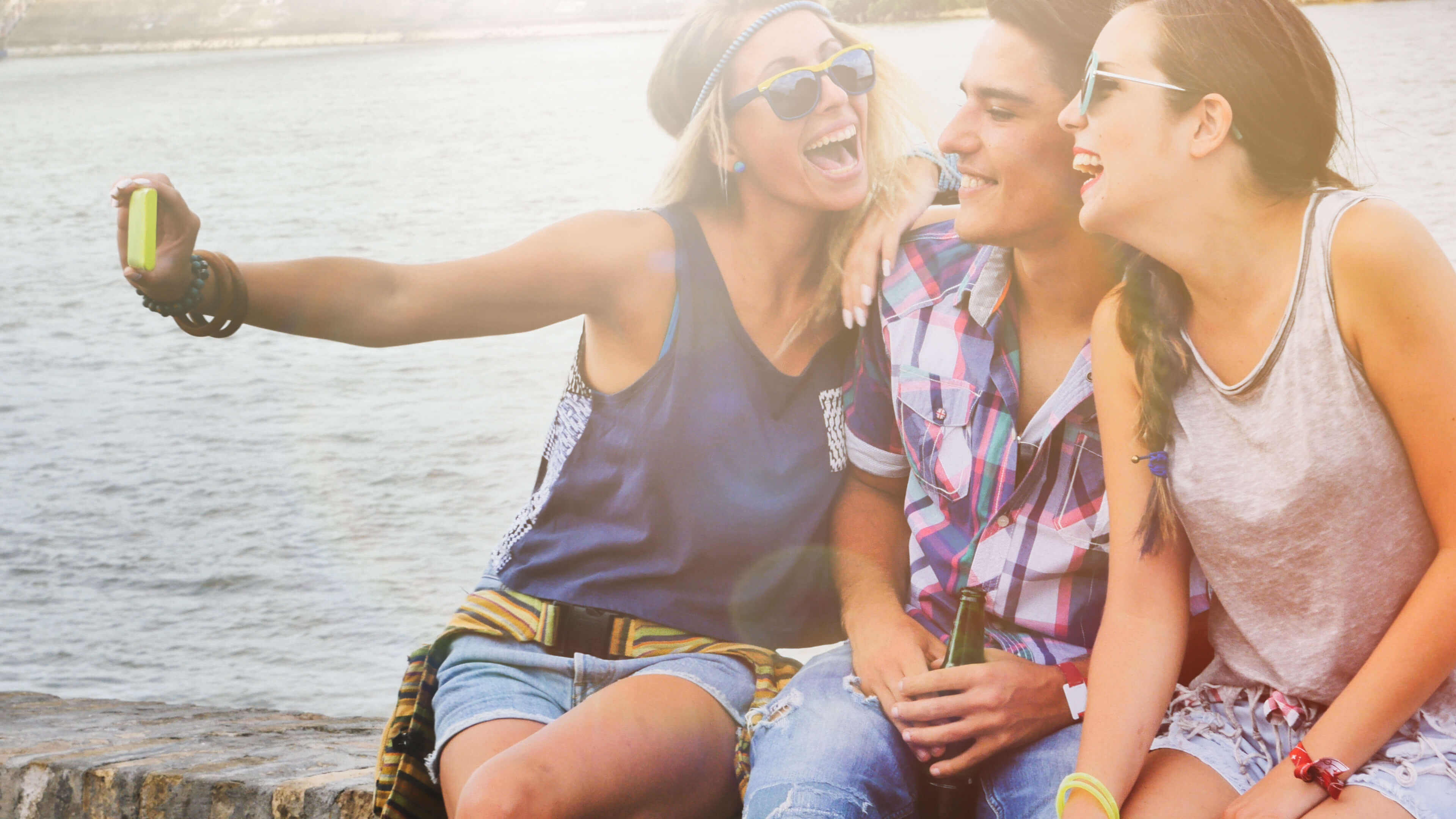 Influencer taking picture with friends, Cunningham Collective makes use of influencers in their marketing strategy.