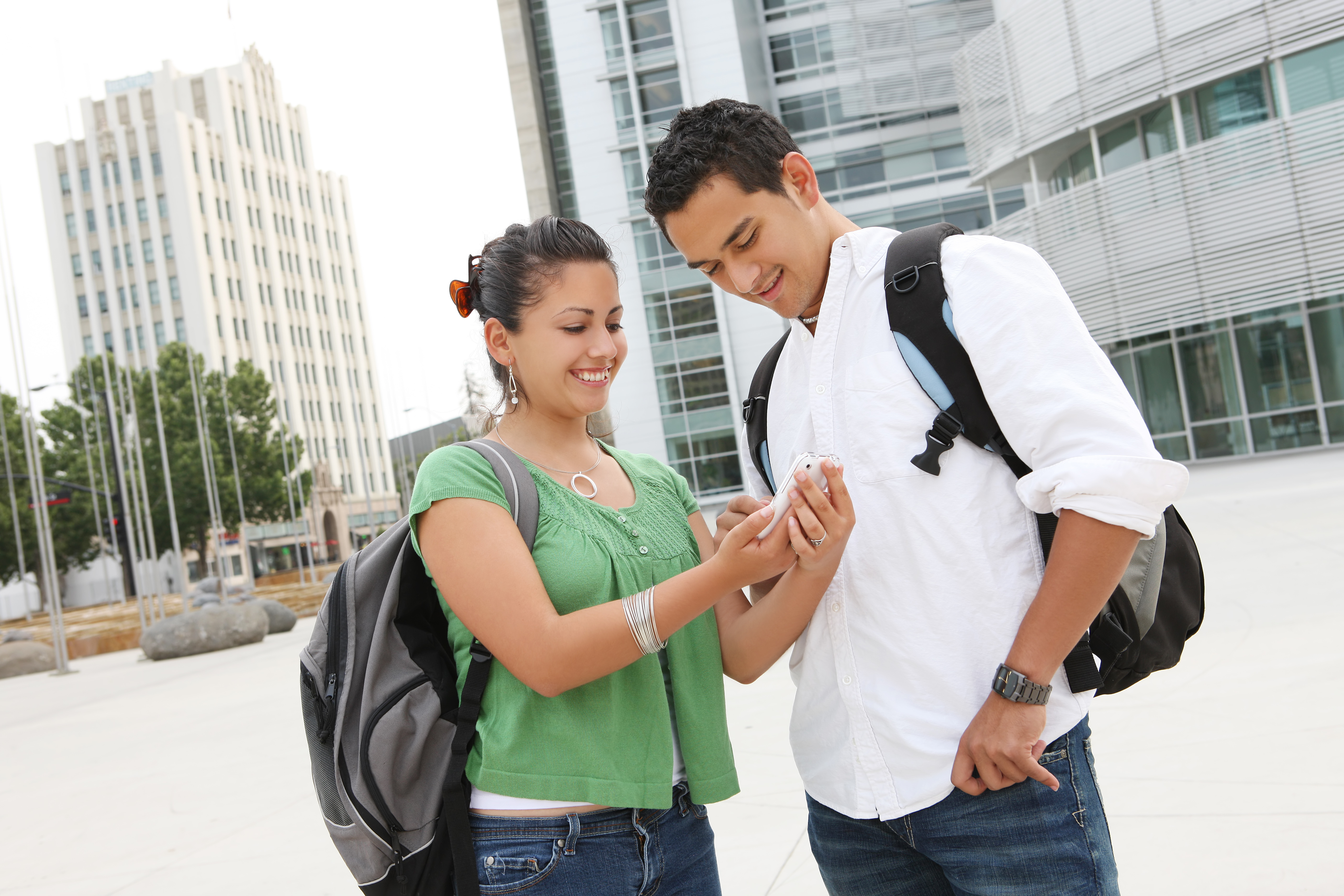Latino teens looking their phones