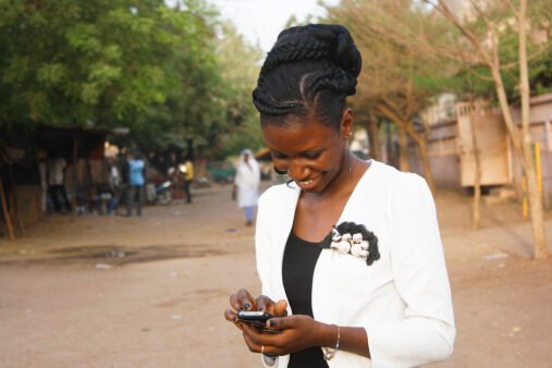Smiling woman with mobile phone