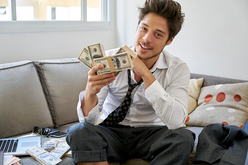Young man with cash money in hand