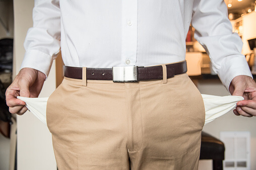 Midsection Of Man Showing With Empty Pockets