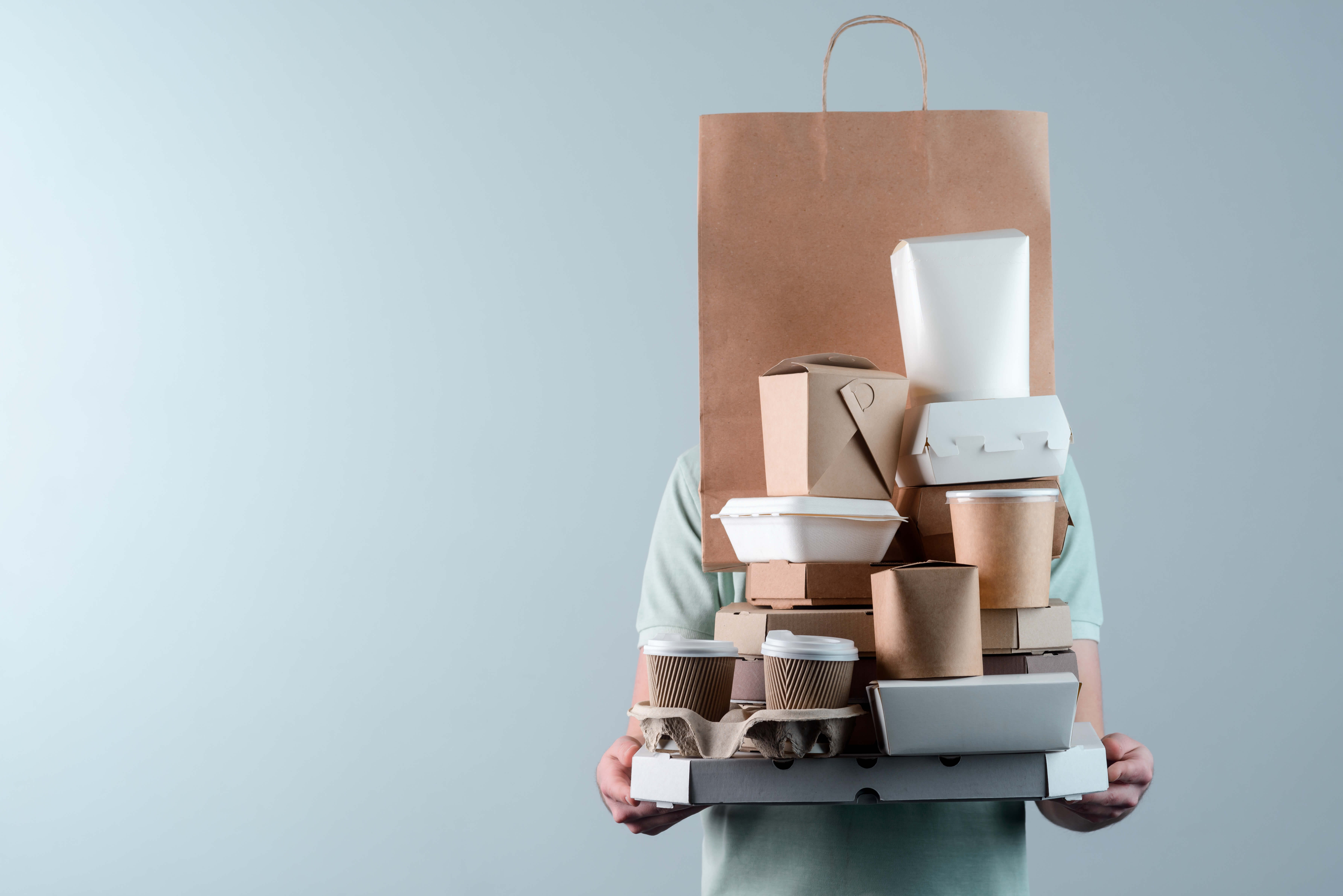 person holding many takeout containers